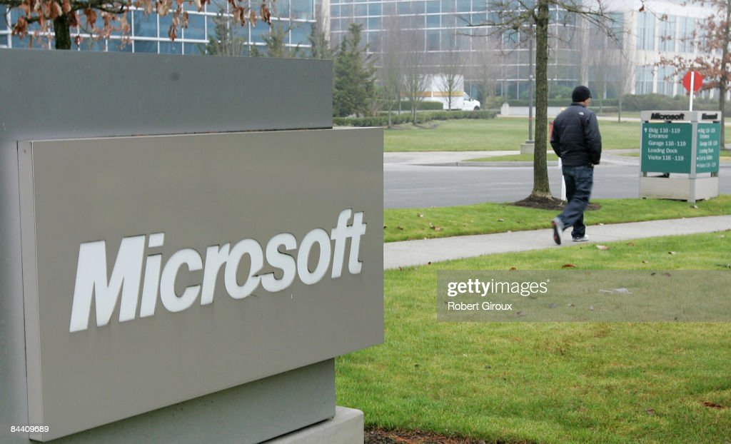 A person walks past a Microsoft sign on January 22, 2009 in Redmond, Washington. The company annouced earlier today they would be laying off up to 5000 employees within the next 18 months.