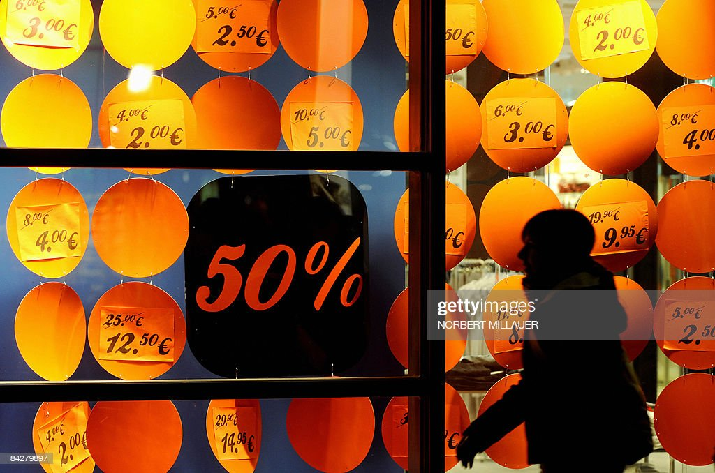 a person walks past a shop window advert pictures getty images
