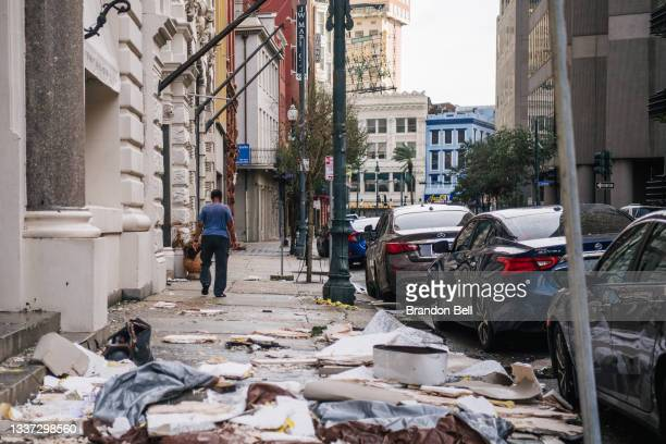 Person walks past debris on the sidewalk after Hurricane Ida passed through on August 30, 2021 in New Orleans, Louisiana. Ida made landfall as a...