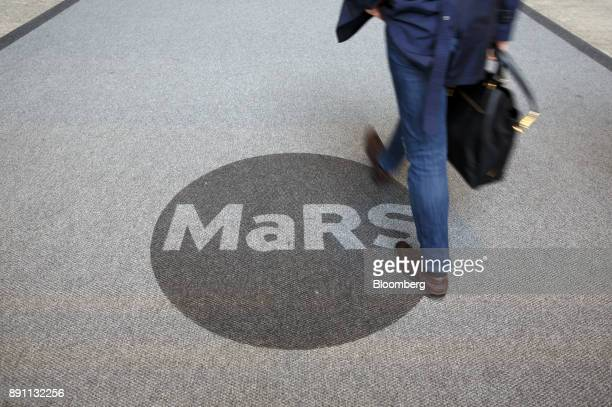 A person walks past signage seen at the MaRS Discovery District in Toronto Ontario Canada on Monday Dec 4 2017 A halfcentury ago Canadian scientists...