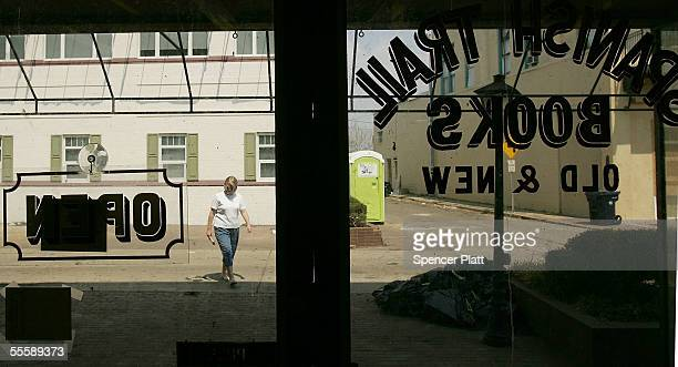 A person walks past Spanish Trail Books September 15 2005 in Biloxi Mississippi While Hundreds of businesses in the city are either wiped out...