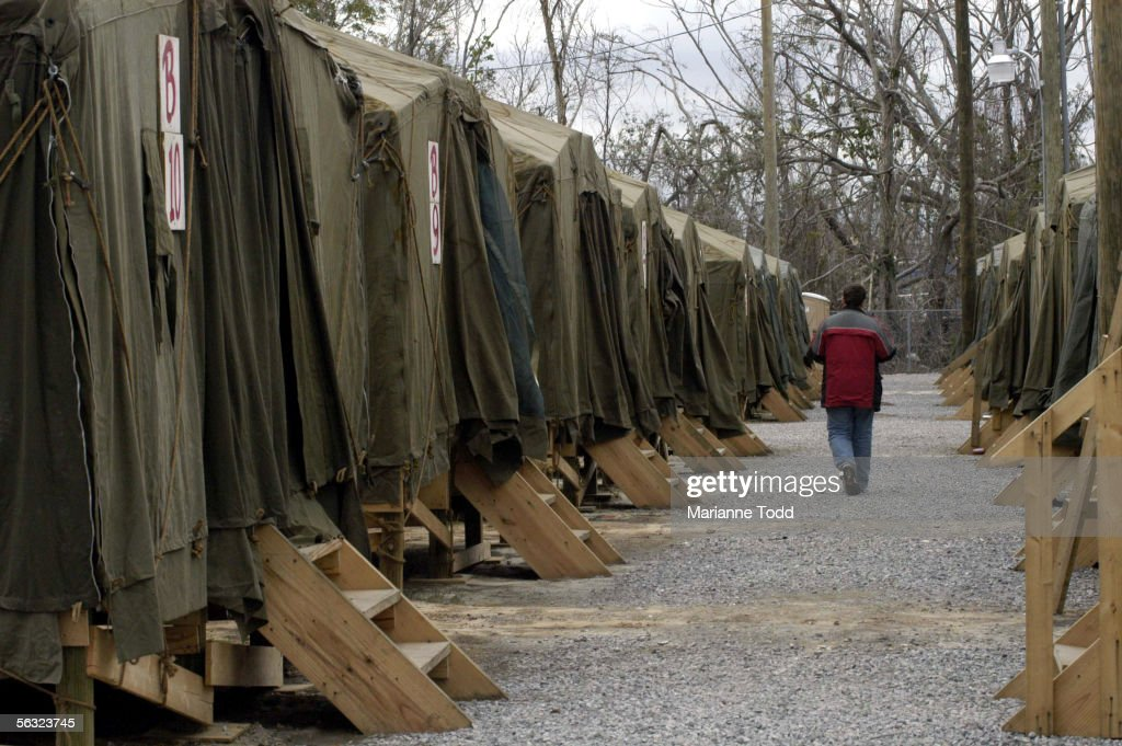 A person walks past tent houses in The Village a makeshift city of tents & Annual Christmas Celebration Goes On In Devastated Gulf Coast Town ...