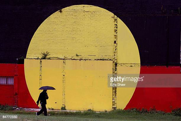 A person walks past the Aboriginal Flag that is painted on the outside of theTony Mundine Gym which was used as a warm up gym for the Night Of The...