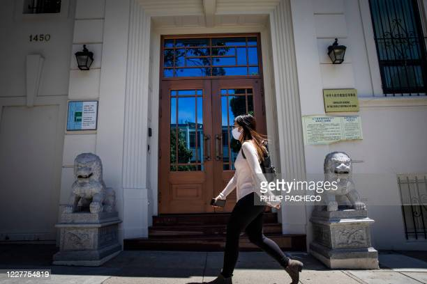 Person walks past the Consulate General of the People's Republic of China in San Francisco, California on July 23, 2020. - The US Justice Department...