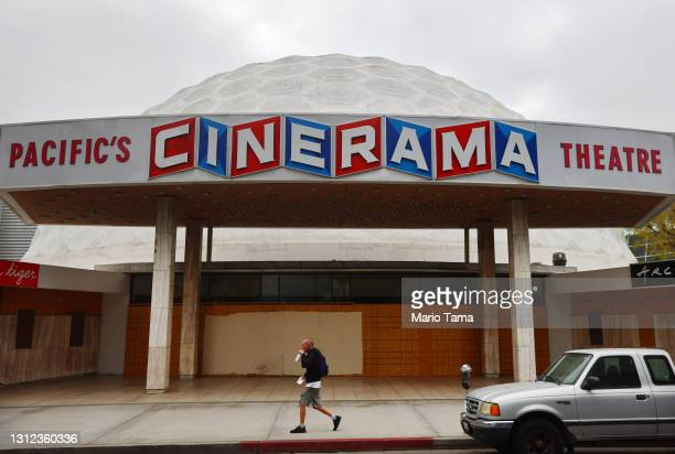 Person walks past the famed Cinerama Dome at the shuttered ArcLight Hollywood movie theater on April 13, 2021 in Los Angeles, California. Decurion,...