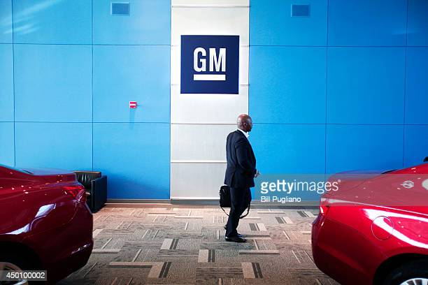 A person walks past the GM logo at the General Motors Technical Center as General Motors Chief Executive Officer Mary Barra holds a press conference...