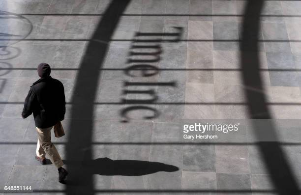 A person walks past the logo of Time Inc in the lobby of their office headquarters in lower Manhattan on March 3 2017 in New York City