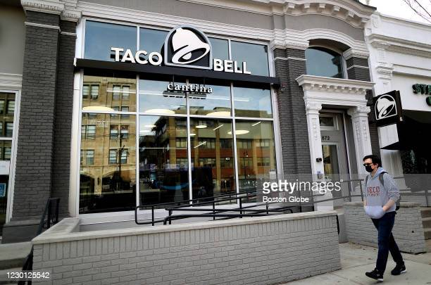 Person walks past the new Taco Bell Cantina in Brookline, MA on Dec. 4, 2020. The new Taco Bell on Boston University's campus on Commonwealth Ave....