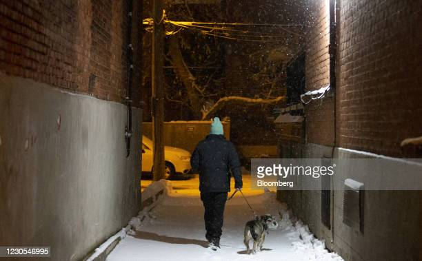 Person walks their dog during curfew hours in Montreal, Quebec, Canada, on Monday, Jan. 11, 2021. Quebec has implemented a curfew, Canadas first of...