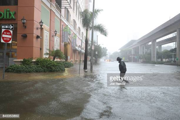 A person walks through a flooded street in the Brickell area of downtown as Hurricane Irma passes through on September 10 2017 in Miami Florida...