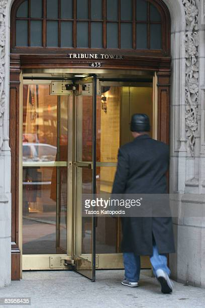 A person walks through a revolving door as the Tribune Co publisher of the Chicago Tribune and Los Angeles Times sought bankruptcy court protection...