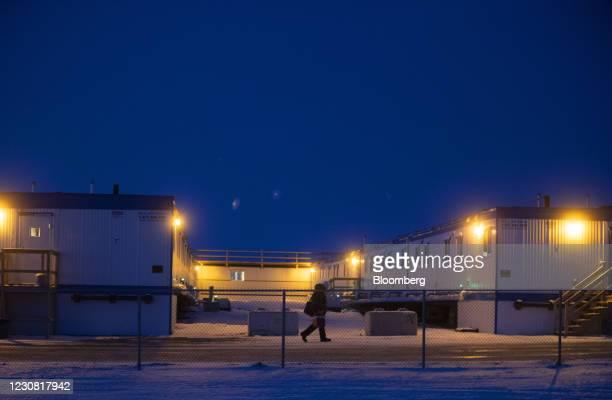 Person walks through a work camp for the Keystone XL pipeline in Oyen, Alberta, Canada, on Tuesday, Jan. 26, 2021. U.S. President Joe Biden...