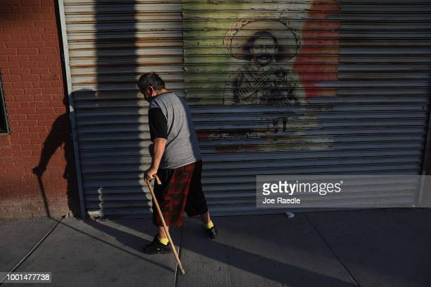 A person walks through downtown near the border crossing with Mexico on July 18 2018 in El Paso Texas A courtordered July 26th deadline is...