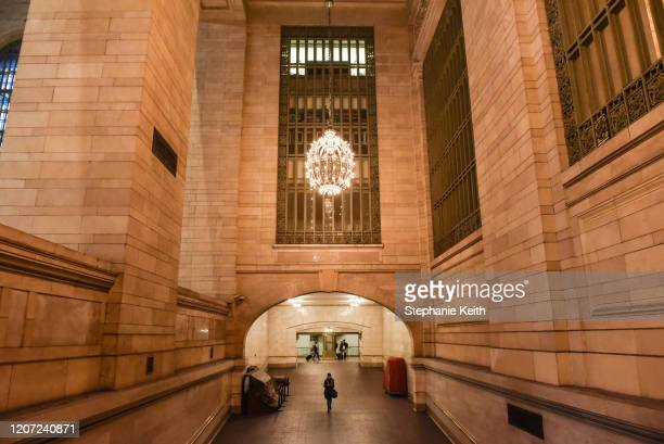 Person walks through Grand Central Terminal in Manhattan on March 15, 2020 in New York City. The World Health Organization declared COVID-19 a global...