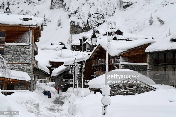 A person walks through the village of Val d'Isere as the precautions are put into place due to an avalanche alert in the French Alpes on January 9...