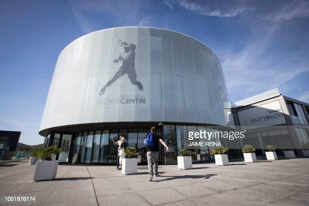 "Person walks to the ""Rafa Nadal Academy"" in Manacor on the Spanish Balearic island of Majorca, on October 11, 2018."