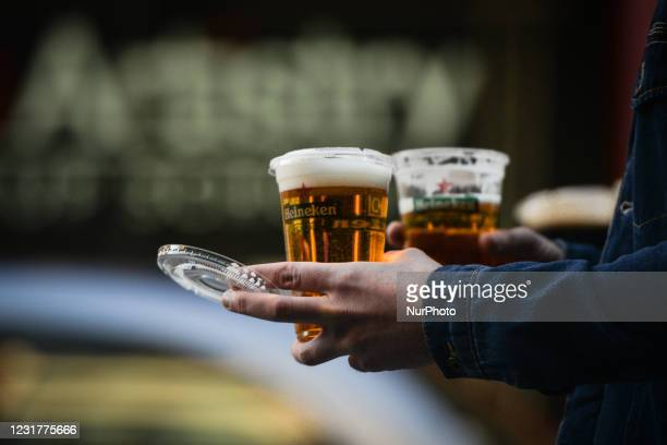 Person walks with a take away beers on St. Patrick's Day as public events in Ireland were cancelled due to Level 5 Covid-19 lockdown. On Wednesday,...