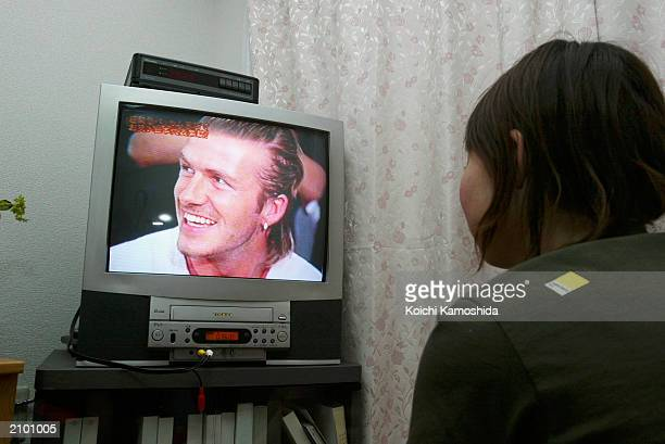 A person watches England Football captain David Beckham on channel 8 Fuji TV June 21 2003 in Tokyo Japan The Beckhams are currently in Japan on...