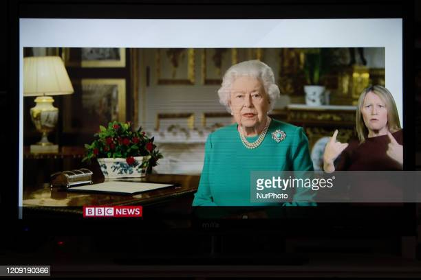 Person watches on TV as the Queen Elizabeth addresses the nation. The Queen promises the nation that better days are ahead - and, echoing the words...