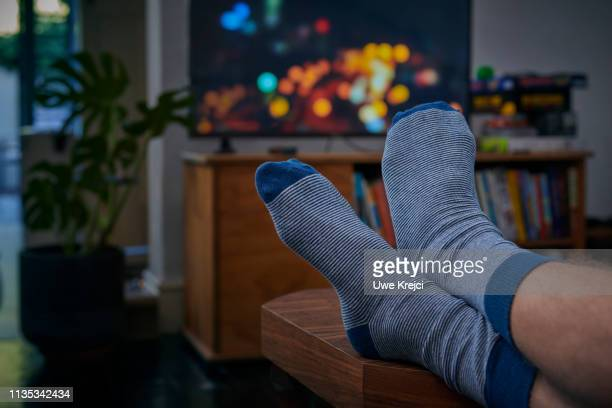 person watching tv - feet up stock pictures, royalty-free photos & images