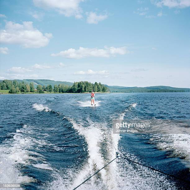 Person waterskiing on lake
