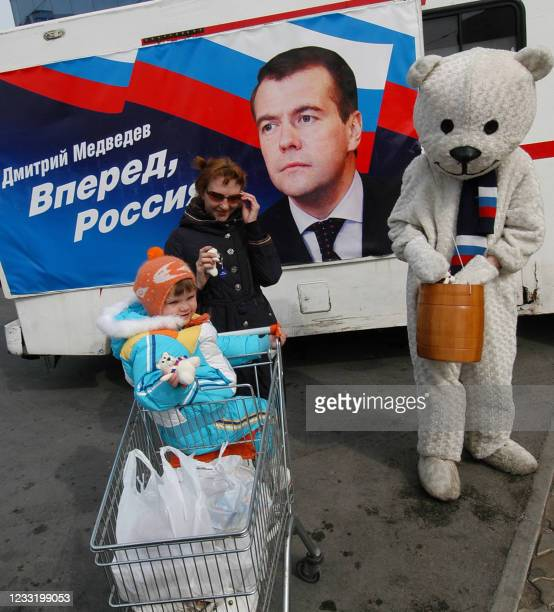 Person wearing a bear costume campaigns for presidential favorite Dmitry Medvedev in Vladivostok on February 26, 2008. There are four registered...