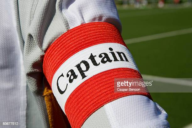 A person wearing a 'captain' arm band