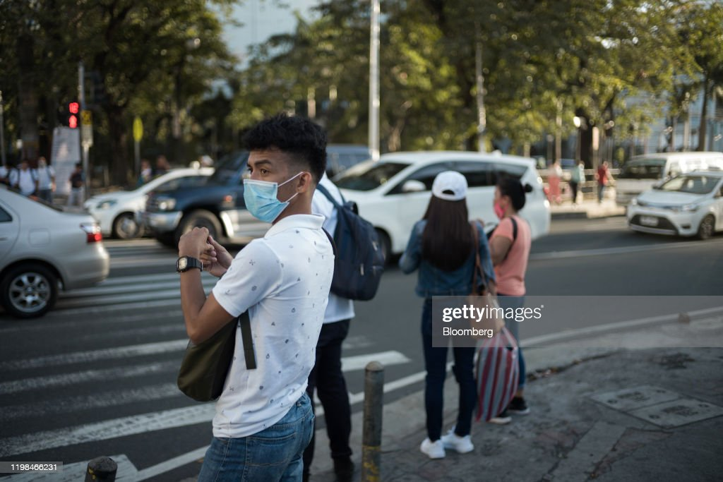 Reactions In Manila As Philippines Reports Virus Casualty : News Photo