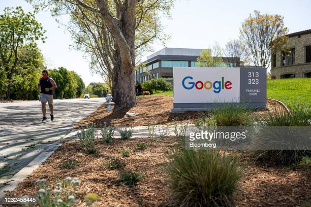 Person wearing a protective masks runs past a Google campus in Mountain View, California, U.S., on Wednesday, April 21, 2021. Silicon Valley has the...