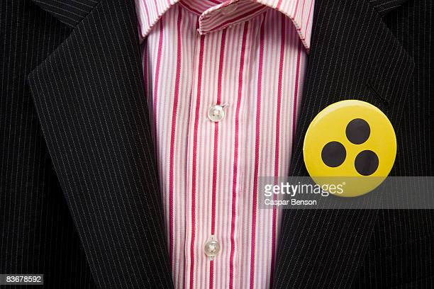 a person wearing a toxic warning badge on his jacket - striped suit stock pictures, royalty-free photos & images
