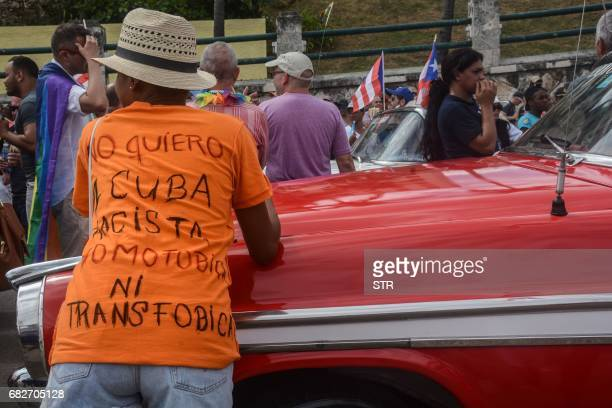 A person wearing a tshirt reading 'I don't want a racist homophobic or transphobic Cuba' takes part in the gay pride parade during the celebration of...