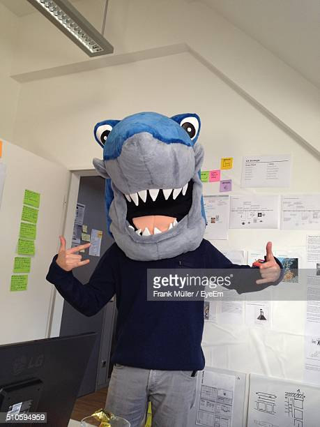 Person wearing animal costume in office
