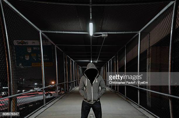 Person Wearing Hooded Shirt Standing On Footbridge At Night