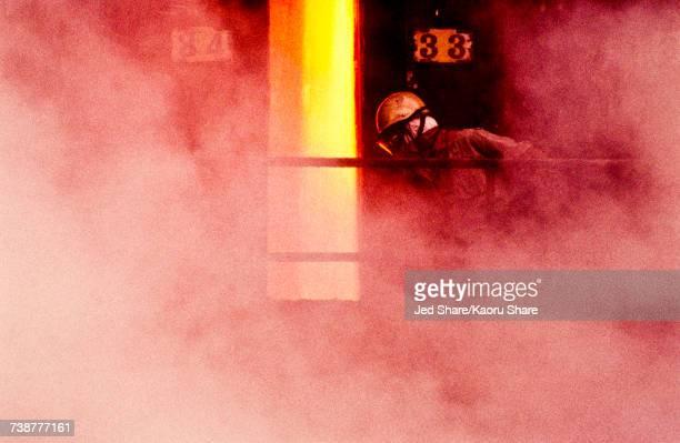 Person wearing mask in smoke