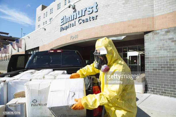 A person wearing protective clothing and a respirator mask donates protective equipment to the Elmhurst Hospital Center in the Queens borough of New...
