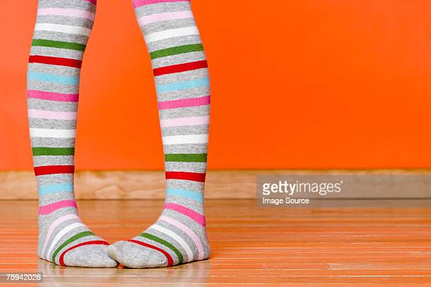 Person wearing striped tights
