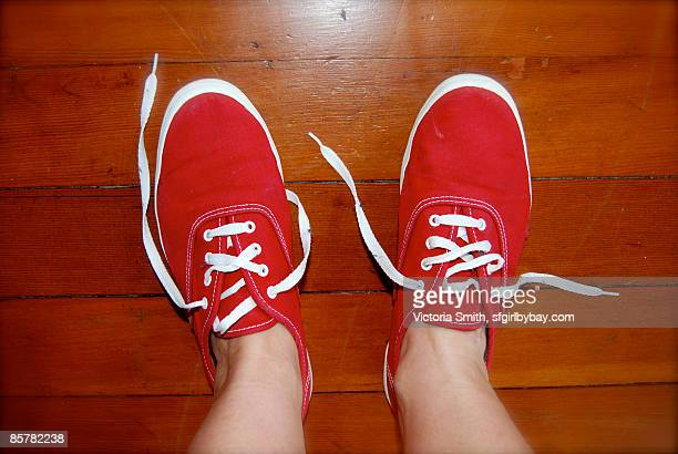 Person wearing tennis shoe, overhead view