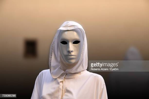 Person Wearing White Mask Against Mirror