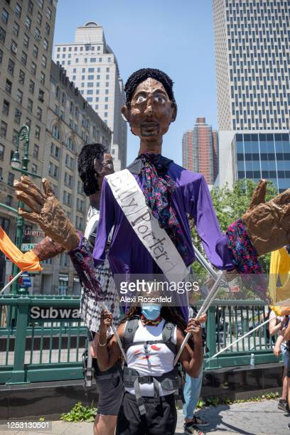 A person wears a Billy Porter puppet as part of artist Chris Williams' Pride Puppets at the Queer Liberation March for Black Lives Against Police...