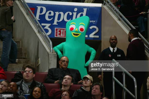 Person wears a costume of the television character Gumby while watching the game from the stands between the New York Knicks and the Philadelphia...