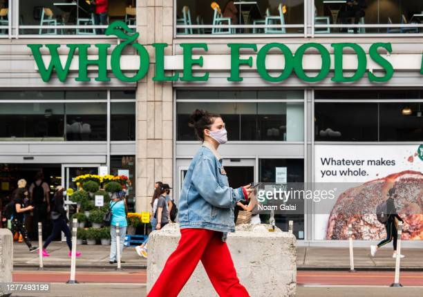 Person wears a face mask outside Whole Foods Market in Union Square as the city continues Phase 4 of re-opening following restrictions imposed to...