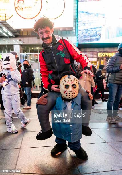 Person wears a Jason Voorhees costume in Times Square on October 31, 2020 in New York City. Many Halloween events have been canceled or adjusted with...