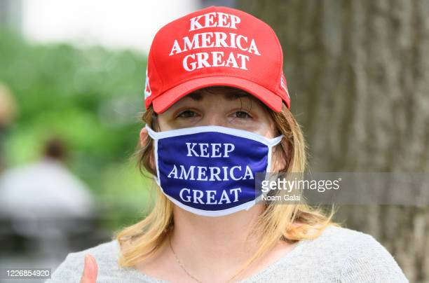 """Person wears a """"Keep America Great"""" protective face mask during the coronavirus pandemic on May 24, 2020 in New York City. Government guidelines..."""