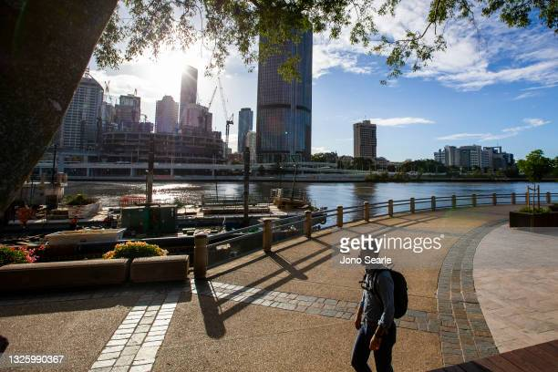 Person wears a mask at Southbank, on June 29, 2021 in Brisbane, Australia. New restrictions have come into effect across parts of Queensland as of 1...