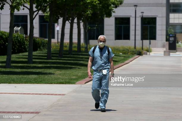 A person wears a mask walking on UCLA's campus on May 25 2020 in Westwood California Government guidelines encourage wearing a mask in public with...