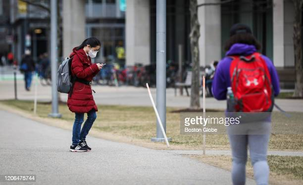 CAMBRIDGE MA MARCH 10 A person wears a mask while walking though MIT's campus in Cambridge MA on March 10 2020 Some colleges have moved all classes...