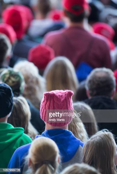 A person wears a pink hat during a rally for US President Donald Trump on October 24 2018 in Mosinee Wisconsin The latest Trump Rally comes as Gov...