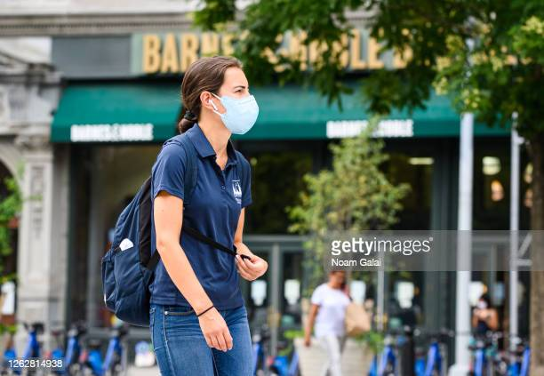 Person wears a protective face mask outside Barnes & Noble in Union Square as the city continues Phase 4 of re-opening following restrictions imposed...