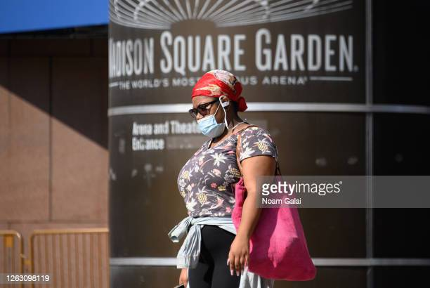 A person wears a protective face mask outside the Madison Square Garden as the city continues Phase 4 of reopening following restrictions imposed to...