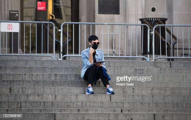 A person wears a protective face mask outside The Metropolitan Museum of Art during the coronavirus pandemic on May 2 2020 in New York City COVID19...